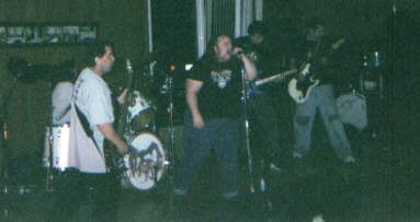 The band playing live. Not the best quality pic but it's a new one. May 28, 2005